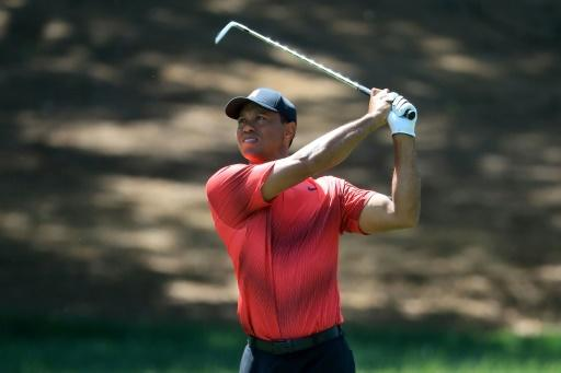 Tiger Woods plays his second shot from the second fairway