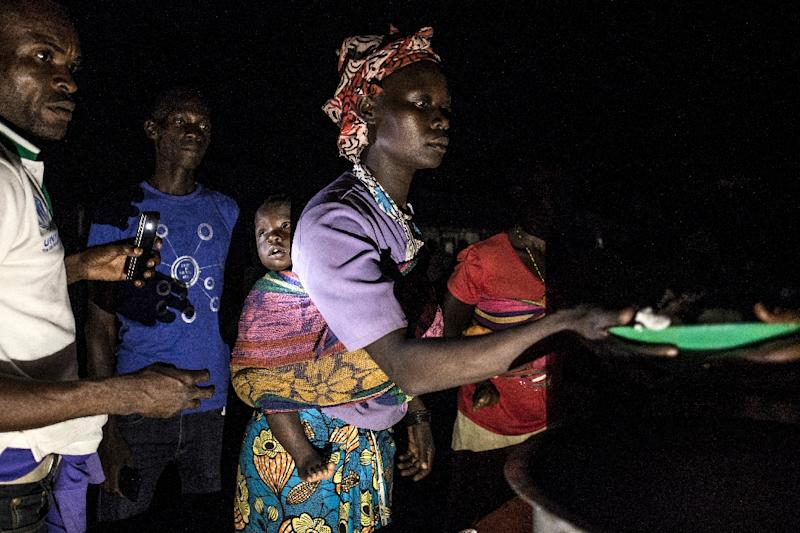 """""""Among the refugees... there are a lot of widows, as well as unaccompanied children,"""" said Andreas Kirchhof, spokesman of the UN refugee agency UNHCR in the DR Congo (AFP Photo/JOHN WESSELS)"""