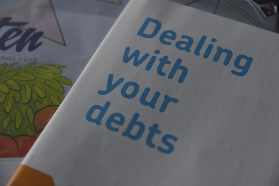 A paper booklet, on Wednesday 16th September 2015, written by the Money Advice Trust in partnership with the Royal Bank of Scotland Group, provided by the Citizen's Advice Bureau in the United Kingdom, advising a reader on how to relieve their personal debt. (Photo by Jonathan Nicholson/NurPhoto) (Photo by NurPhoto/NurPhoto via Getty Images)