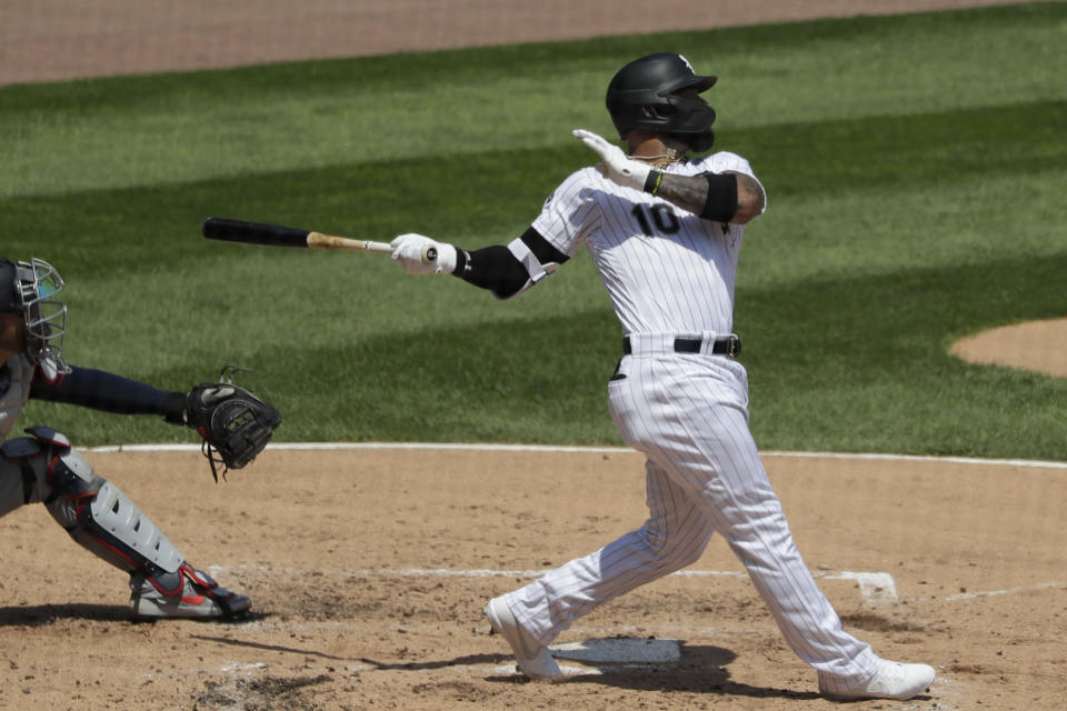 Chicago White Sox's Yoan Moncada hits a one-run double during the third inning of a baseball game against the Minnesota Twins in Chicago, Saturday, July 25, 2020. (AP Photo/Nam Y. Huh)