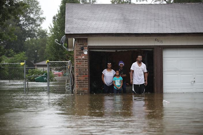 People wait to be rescued from their flooded homes in Houston.