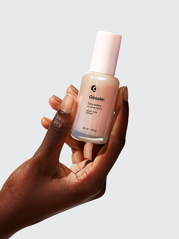 """<p><strong>Glossier</strong></p><p>glossier.com</p><p><a href=""""https://go.redirectingat.com?id=74968X1596630&url=https%3A%2F%2Fwww.glossier.com%2Fproducts%2Ffuturedew&sref=https%3A%2F%2Fwww.harpersbazaar.com%2Fbeauty%2Fmakeup%2Fg36662415%2Fglossier-sale-2021%2F"""" rel=""""nofollow noopener"""" target=""""_blank"""" data-ylk=""""slk:Shop Now"""" class=""""link rapid-noclick-resp"""">Shop Now</a></p><p><strong><del>$24</del> $19 (20% off)</strong></p><p>Glossier's nourishing, non-greasy Futuredew serum is another cult-favorite. This goes to work in creating a naturally glowing, well-moisturized look. Use this as the last step in your skincare/makeup routine.</p>"""