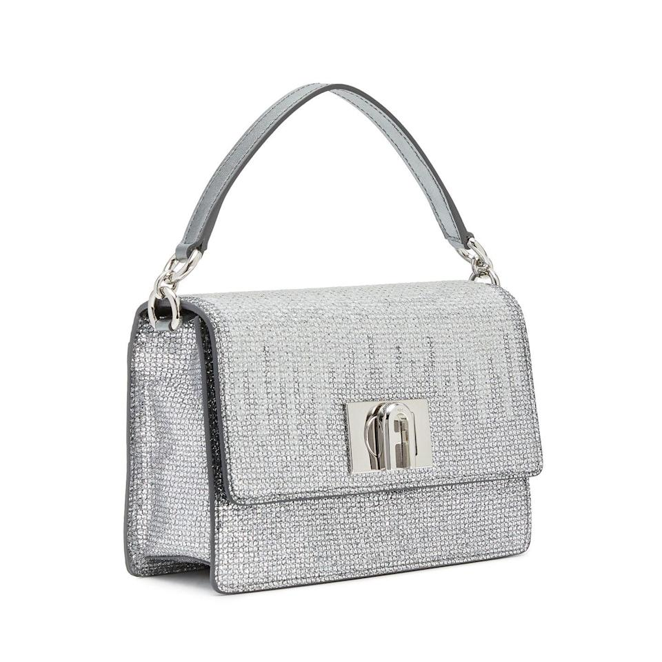 """<p><strong>Who: </strong>Furla</p><p><strong>What: </strong>Limited-edition Gala bags</p><p><strong>Where:</strong> Available on <a href=""""https://go.redirectingat.com?id=74968X1596630&url=https%3A%2F%2Fwww.furla.com%2Fus%2Fen%2Feshop%2Flanding-pages%2Fgala-2021%2F&sref=https%3A%2F%2Fwww.elle.com%2Ffashion%2Fshopping%2Fg37500051%2Fthe-launch-septembers-hottest-fashion-launches%2F"""" rel=""""nofollow noopener"""" target=""""_blank"""" data-ylk=""""slk:furla.com"""" class=""""link rapid-noclick-resp"""">furla.com</a></p><p><strong>Why: </strong>Just in time for the Met Gala, Furla reimagines two of its most popular silhouettes in glamorous metallics that match the energy of fashion's biggest night. Both the 1927 Soft bag and the Moon bag glisten with degrade metal studs and metal crossbody straps, embodying the nighttime excitement of New York. The Moon bag retails for $348 and the 1927 Soft retails for $428.</p><p><a class=""""link rapid-noclick-resp"""" href=""""https://go.redirectingat.com?id=74968X1596630&url=https%3A%2F%2Fwww.furla.com%2Fus%2Fen%2Feshop%2Flanding-pages%2Fgala-2021%2F&sref=https%3A%2F%2Fwww.elle.com%2Ffashion%2Fshopping%2Fg37500051%2Fthe-launch-septembers-hottest-fashion-launches%2F"""" rel=""""nofollow noopener"""" target=""""_blank"""" data-ylk=""""slk:SHOP NOW"""">SHOP NOW</a></p>"""