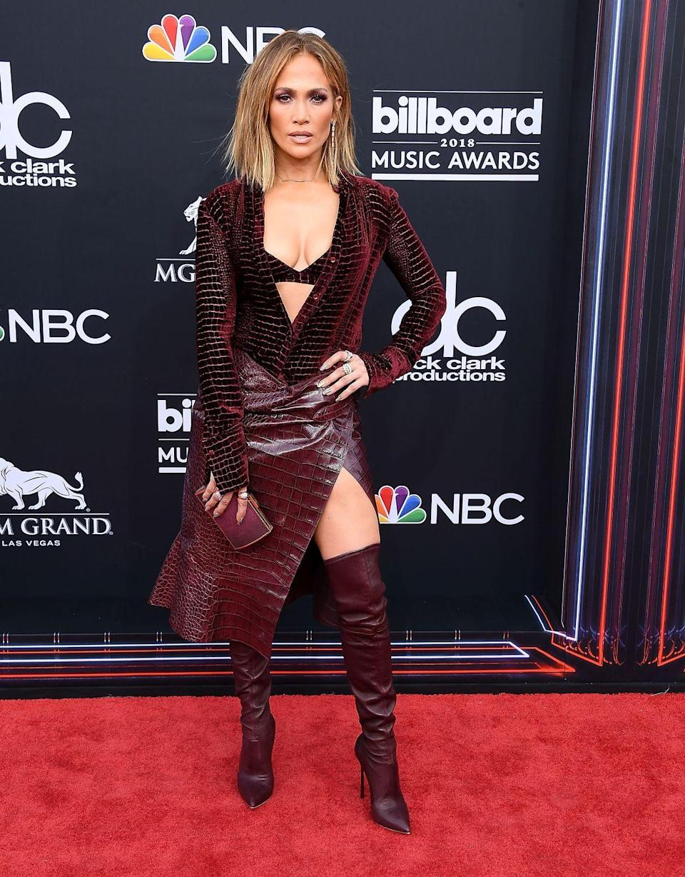 <p>Here she is at the 2018 Billboard Awards wearing a burgundy toned leather-look getup with matching boots.</p>