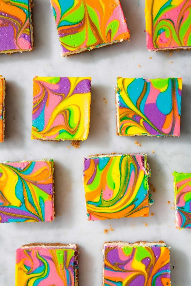"<p>Don't be shy with the food coloring—look how pretty these are! </p><p>Get the recipe from <a href=""https://www.delish.com/cooking/recipe-ideas/recipes/a56497/rainbow-vanilla-cheesecake-bars-recipe/"" target=""_blank"">Delish</a>.</p>"