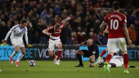 Britain Soccer Football - Middlesbrough v Sunderland - Premier League - The Riverside Stadium - 26/4/17 Sunderland's Billy Jones in action with Middlesbrough's Adam Clayton as referee Mike Dean falls over Reuters / Phil Noble Livepic