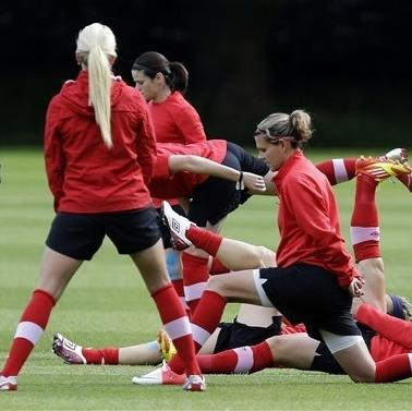 Canada's Christine Sinclair, center foreground, and Melissa Tancredi, center rear, train with teammates during a women's soccer practice session for the 2012 London Summer Olympics, in Manchester, England, Sunday, Aug. 5, 2012. (AP Photo/Hussein Malla)