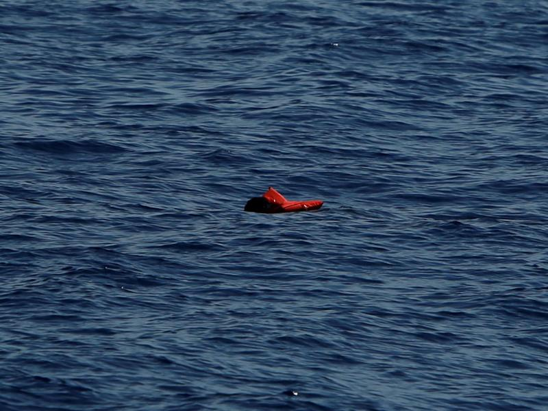 A dead man in a life jacket floats in the Mediterranean Sea after a boat disaster off the coast of Libya on 16 April (Reuters)