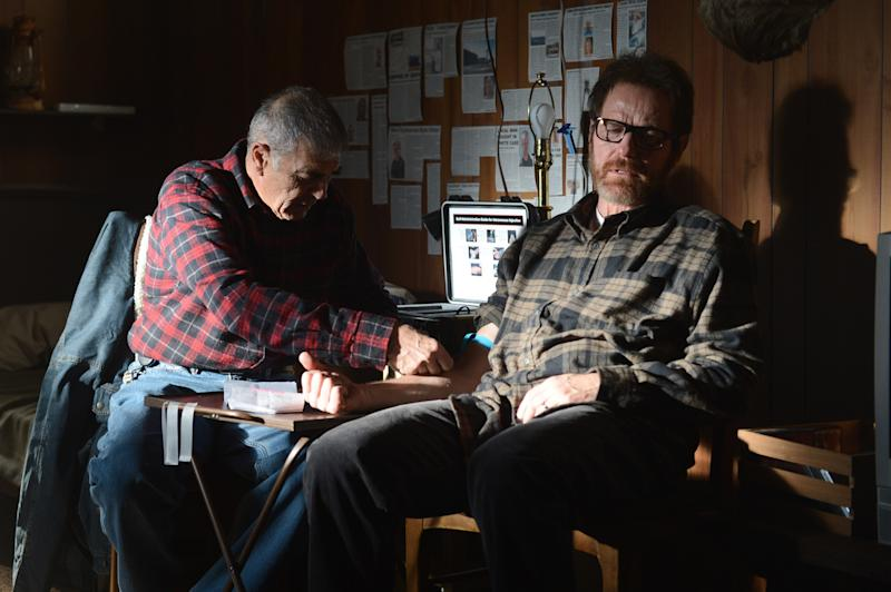 """This image released by AMC shows Robert Forster, left, and Bryan Cranston in a scene from """"Breaking Bad,"""" which aired on Sunday, Sept. 22. The Nielsen company said that on the same night that """"Breaking Bad"""" won an Emmy Award for best drama, the penultimate episode of that AMC series set a viewership record. An estimated 6.6 million people watched """"Breaking Bad"""" on Sunday, which was airing the same time the cast got its award. (AP Photo/AMC, Ursula Coyote)"""