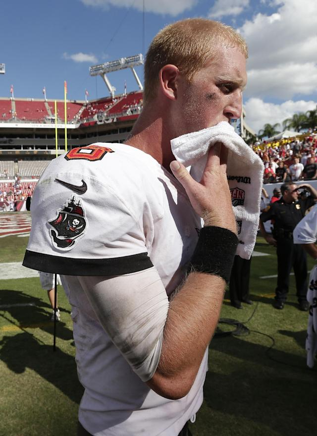 Tampa Bay Buccaneers quarterback Mike Glennon (8) wipes his face as he leaves the field following the team's 13-10 loss to the Arizona Cardinals in an NFL football game on Sunday, Sept. 29, 2013, in Tampa, Fla. (AP Photo/Chris O'Meara)