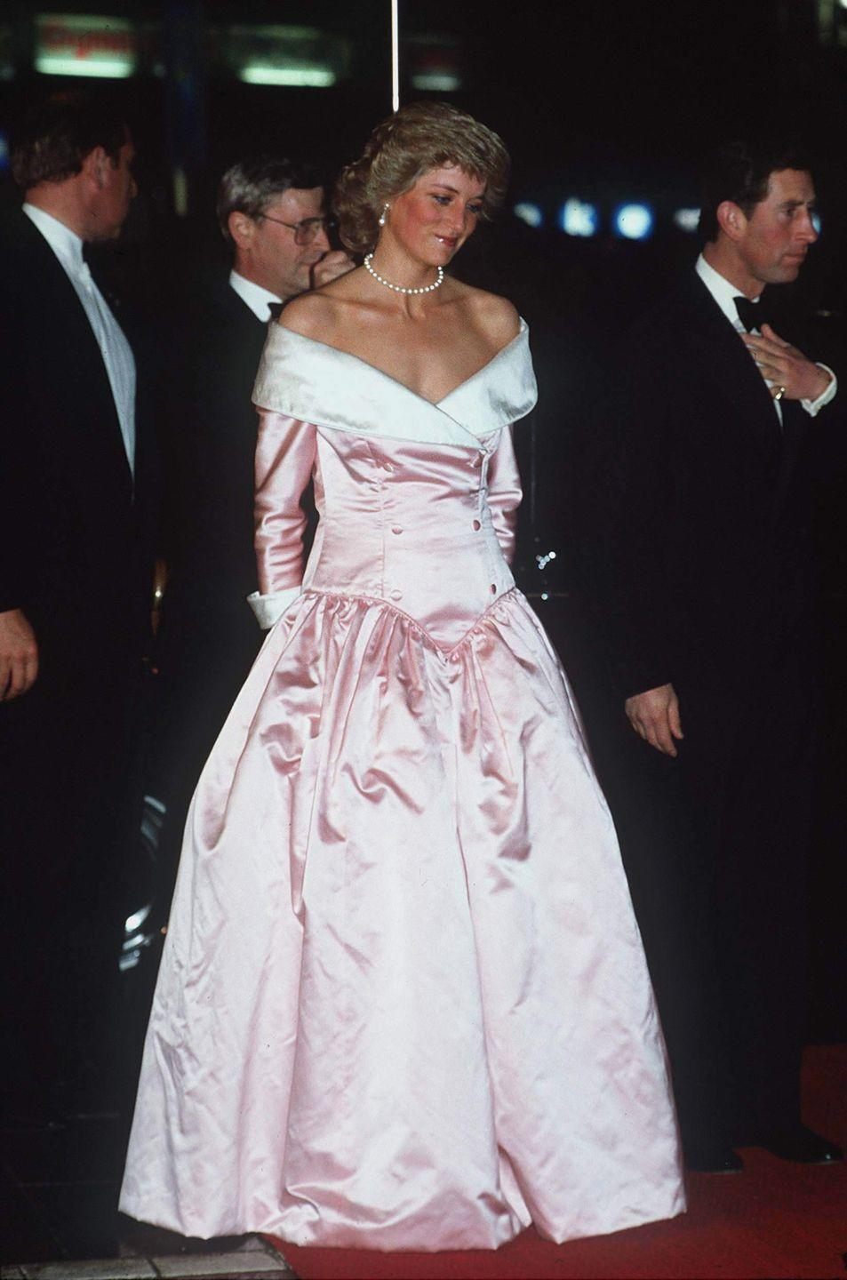 <p>We wonder if Catherine Walker had seen <em>Sleeping Beauty </em>when she designed this blush off-the-shoulder evening gown. Between the white folded neckline and the drop-waist silhouette, Diana looked just like Aurora during a visit to Germany in 1987. </p>