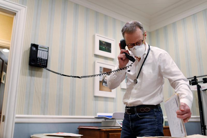 Dr Greg Gulbransen takes part in a telemedicine call with a patient while maintaining visits with both his regular patients and those confirmed to have the coronavirus disease (COVID-19) at his pediatric practice in Oyster Bay, New York, U.S., April 13, 2020. Picture taken April 13, 2020. REUTERS/Lucas Jackson (Photo: Lucas Jackson / reuters)