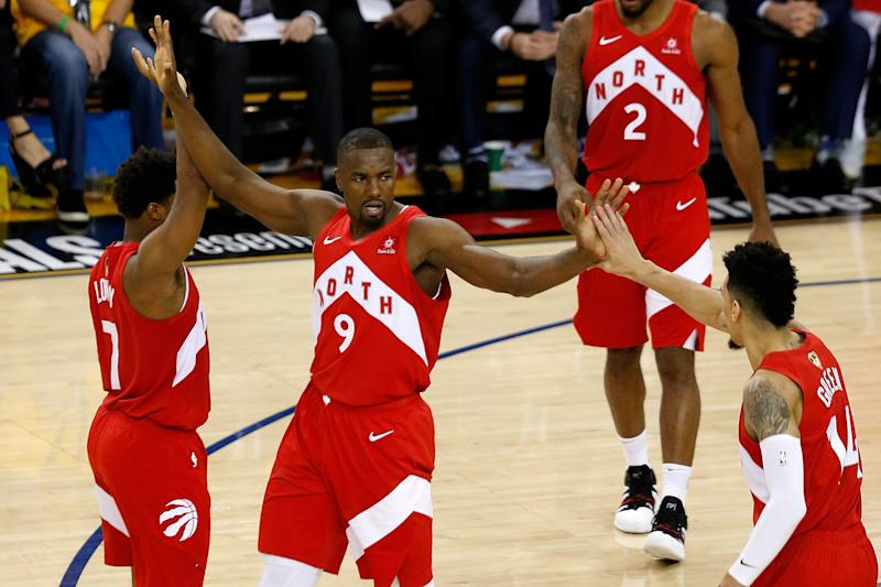 OAKLAND, CALIFORNIA - JUNE 07: Serge Ibaka #9 of the Toronto Raptors celebrates the basket against the against the Golden State Warriors during Game Four of the 2019 NBA Finals at ORACLE Arena on June 07, 2019 in Oakland, California. NOTE TO USER: User expressly acknowledges and agrees that, by downloading and or using this photograph, User is consenting to the terms and conditions of the Getty Images License Agreement. (Photo by Lachlan Cunningham/Getty Images)