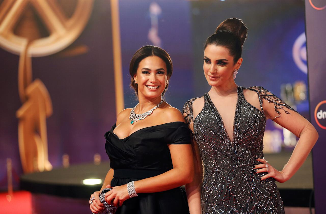 Tunisian actors Hend Sabry (L) and Dorra Zarrouk pose during the opening of the 39th Cairo International Film Festival in Cairo, Egypt November 21, 2017. REUTERS/Amr Abdallah Dalsh