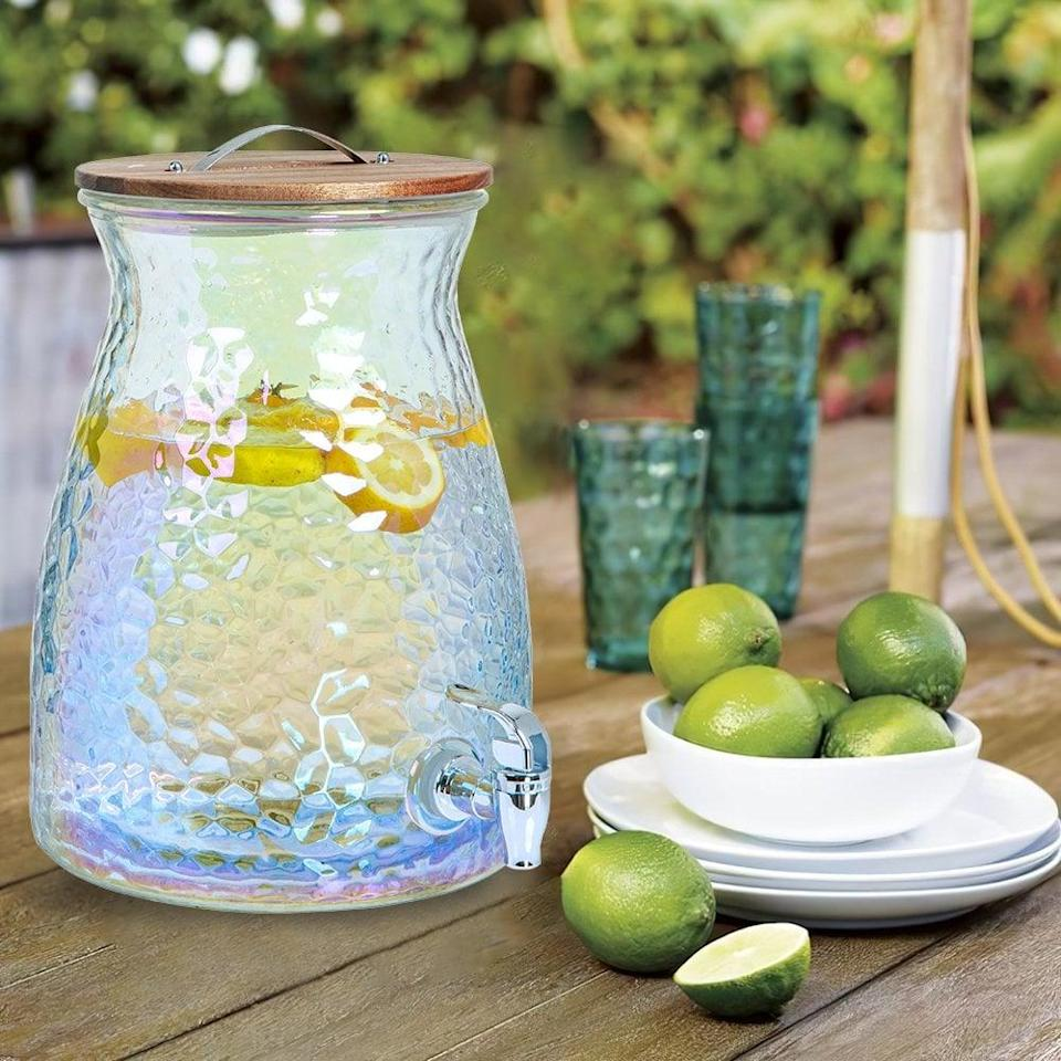 <p>How chic is this <span>Better Homes &amp; Gardens Hammered Luster Beverage Dispenser</span> ($14) for the summer!? Make mimosas, spa waters, and fresh lemonade all summer long.</p>