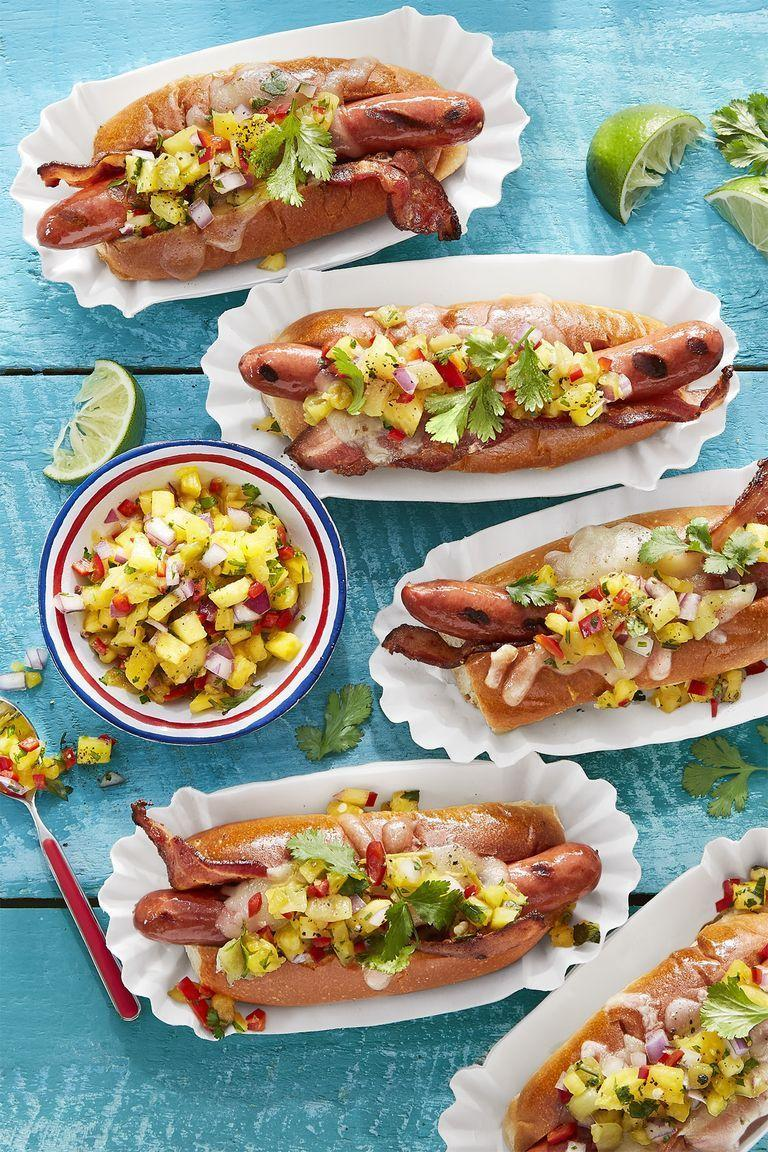 "<p>If you enjoy tropical flavors, you'll find an instant favorite in this hot dog recipe. Featuring pineapple, red onion, cilantro, and lime juice, one bit in and you'll swear you're on a beach.</p><p><i><strong>Get the recipe at <a href=""https://www.countryliving.com/food-drinks/recipes/a43064/hatch-pineapple-salsa-recipe/"" rel=""nofollow noopener"" target=""_blank"" data-ylk=""slk:Country Living"" class=""link rapid-noclick-resp"">Country Living</a>.</strong></i></p>"