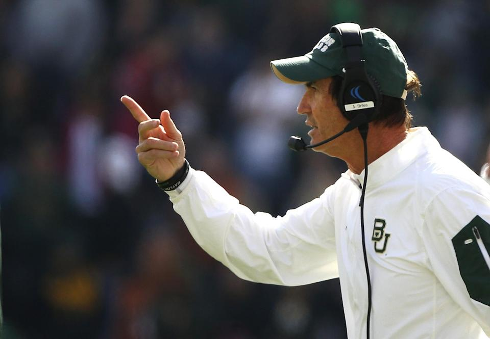 Former Baylor coach Art Briles is supported by his assistant coaches. (Getty)
