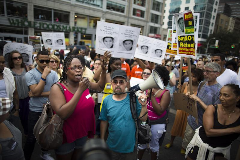 Demonstrators converge on Union Square in New York Sunday, July 14, 2013 during a protest against the acquittal of neighborhood watch member George Zimmerman in the killing of 17-year-old Trayvon Martin in Florida. Demonstrators upset with the verdict protested in Florida, Milwaukee, Washington, Atlanta and other cities overnight and into the early morning Sunday. (AP Photo/John Minchillo)