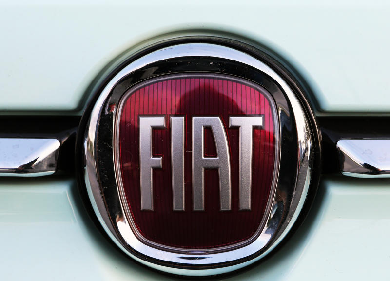 """A Fiat logo pictured on a car in Bayonne, southwestern France, Thursday, Oct.31, 2019.The boards of Fiat Chrysler and PSA Peugeot announced Thursday fast-moving plans to merge the two companies creating the world's fourth-largest automaker with enough scale to confront """"the new era in mobility"""". (AP Photo/Bob Edme)"""