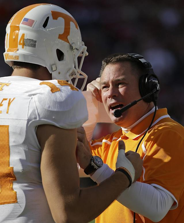 Tennessee head coach Butch Jones talks with quarterback Justin Worley (14) during the first half of an NCAA college football game against Alabama in Tuscaloosa, Ala., Saturday, Oct. 26, 2013. (AP Photo/Dave Martin)