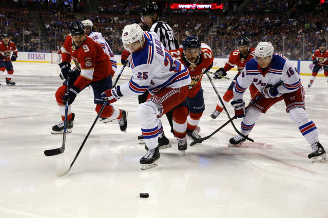 New York Rangers defenseman Libor Hajek (25) controls the puck in the first period as Florida Panthers center Brian Boyle (9) pursues during an NHL hockey game, Saturday, Nov. 16, 2019, in Sunrise, Fla. (AP Photo/Joe Skipper)