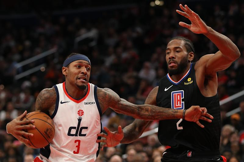 WASHINGTON, DC - DECEMBER 08: Bradley Beal #3 of the Washington Wizards drives in the lane past Kawhi Leonard #2 of the Los Angeles Clippers during the second half at Capital One Arena on December 8, 2019 in Washington, DC. NOTE TO USER: User expressly acknowledges and agrees that, by downloading and or using this photograph, User is consenting to the terms and conditions of the Getty Images License Agreement. (Photo by Patrick Smith/Getty Images)