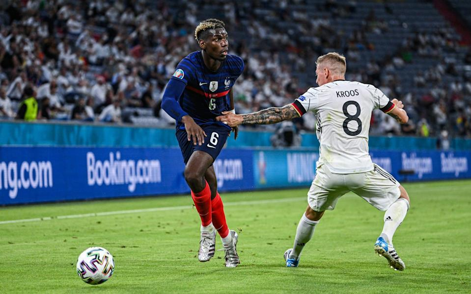 Paul Pogba (L) of France challenges for the ball with Toni Kroos (R) of Germany during the UEFA Euro 2020 Championship Group F match between France and Germany at Allianz Arena on June 15, 2021 in Munich - France vs Germany player ratings: Paul Pogba the standout as world champions begin with a win - GETTY IMAGES