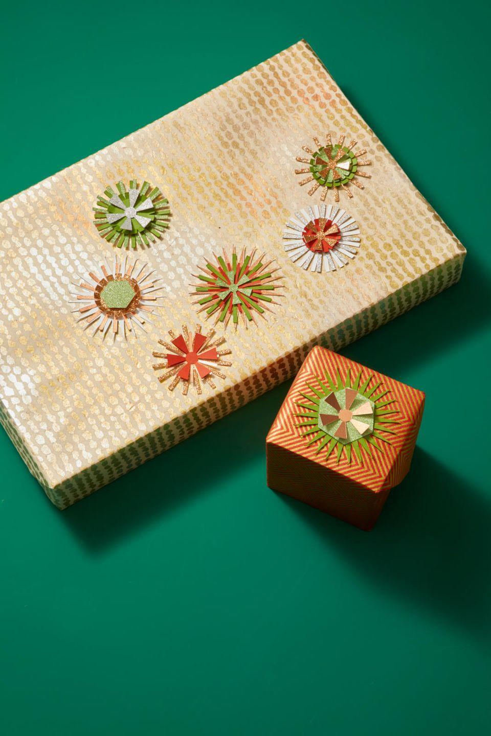 """<p>Once you've made your candles, you can also use the Cricut's starburst template to cut out interesting shapes in a mix of papers. Layer them to make eye-catching gift toppers, and secure them with <a href=""""https://www.amazon.com/Glue-Dots-Contains-Adhesive-08165/dp/B0011N832C?tag=syn-yahoo-20&ascsubtag=%5Bartid%7C10055.g.2996%5Bsrc%7Cyahoo-us"""" rel=""""nofollow noopener"""" target=""""_blank"""" data-ylk=""""slk:glue dots"""" class=""""link rapid-noclick-resp"""">glue dots</a>. Your recipients will be so into it, they'll forget to shake the present and try and figure out what's inside. </p>"""