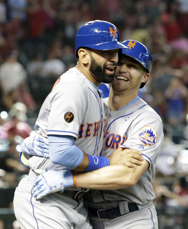 New York Mets' Brandon Nimmo, left, celebrates with Jose Bautista after hitting a two-run home run against the Arizona Diamondbacks in the ninth inning during a baseball game, Sunday, June 17, 2018, in Phoenix. (AP Photo/Rick Scuteri)