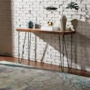 <p>We're into the simplicity of this <span>Rivet Hairpin Wood and Metal Tall Console Bar Table</span> ($233).</p>