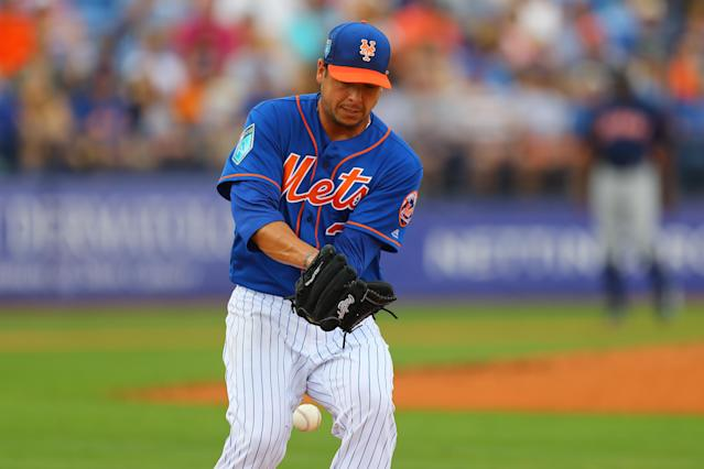 <p>New York Mets pitcher Anthony Swarzak (38) mishandles throw in the third inning of a baseball game against the Houston Astros at First Data Field in Port St. Lucie, Fla., Feb. 27, 2018. (Photo: Gordon Donovan/Yahoo News) </p>