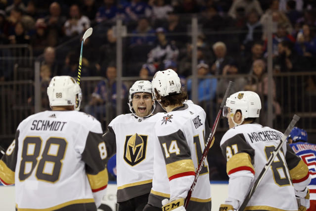Vegas Golden Knights right wing Alex Tuch, second from left, reacts with teammates after scoring his second goal of an NHL hockey game during the first period against the New York Rangers, Monday, Dec. 2, 2019, in New York. (AP Photo/Kathy Willens)