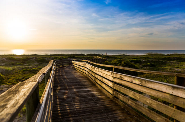 <p>Where: Florida</p><p>Amelia Island on Florida's northeast coast is more than just a tourist destination, it's a down-to-earth seaport community where everyday people live and work. This jewel in the Sea Island chain has a long history including Timucuan Indians; Spanish, French, and British explorers; swashbuckling pirates; late 19th-century millionaires; and today's shrimpers and fishermen. Travelers like the island for its 13 miles of generally crowd-free beaches, Fort Clinch State Park and Amelia Island State Park, and Egan's Creek Greenway, which consists of a hiking/biking trail through 300 acres of protected land encompassing freshwater swamp, salt marsh, and forest. Stately oak trees draped with Spanish moss are a hallmark of this community and the historic downtown neighborhood offers mom-and-pop restaurants, an old-fashioned candy shop, boutique shops, and art galleries. Several bars offer nightly entertainment and events like the Isle of Eight Flags Shrimp Festival draws crowds every year.</p><p>Insider Tip: The destination is called Amelia Island but the town itself has another name. Search for resorts like the Ritz-Carlton, value-oriented hotels and motels, inns, and B&Bs in Fernandina Beach.</p><p><i>(Photo: Courtesy of Amelia Island CVB)</i></p>
