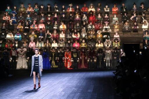 """Louis Vuitton ends Paris fashion week a """"clash of epochs"""" extravaganza at the Louvre museum featuring a 200-person choir in period costumes that went from the 15th century to the 1950s"""
