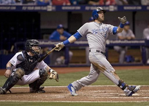 Tampa Bay Rays catcher Ryan Hanigan, left, looks on as Kansas City Royals' Alex Gordon doubles during the eighth inning of a baseball game Monday, July 7, 2014, in St. Petersburg, Fla. (AP Photo/Steve Nesius)