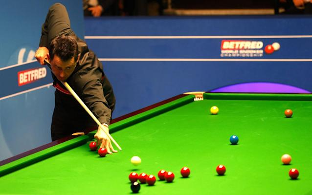<span>Ronnie O'Sullivan in action against Ding Junhui</span> <span>Credit: PA </span>