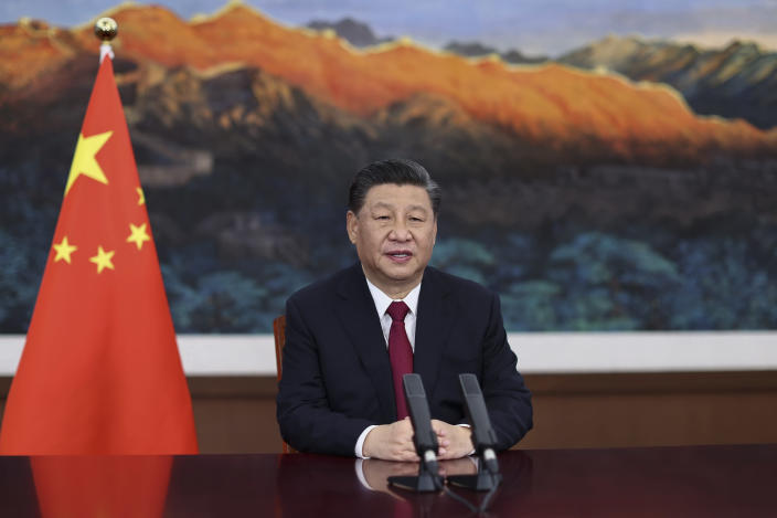 """FILE - In this April 20, 2021 file photo released by Xinhua News Agency, Chinese President Xi Jinping delivers a keynote speech via video for the opening ceremony of the Boao Forum for Asia (BFA) Annual Conference, in Beijing. A seven-month investigation by the Associated Press and the Oxford Internet Institute, a department at Oxford University, found that the rise of Chinese diplomats on Twitter has been powered by an army of apparently fake accounts that have retweeted their posts tens of thousands of times. The move onto Western social media comes as China wages a war for influence – both at home and abroad -- on the internet, which President Xi Jinping has called """"the main battlefield"""" for public opinion. (Ju Peng/Xinhua via AP, File )"""