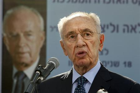Israeli President Shimon Peres gives a speech during a ceremony for late Israeli prime minister Yitzhak Rabin at the Mount Herzl cemetery in Jerusalem