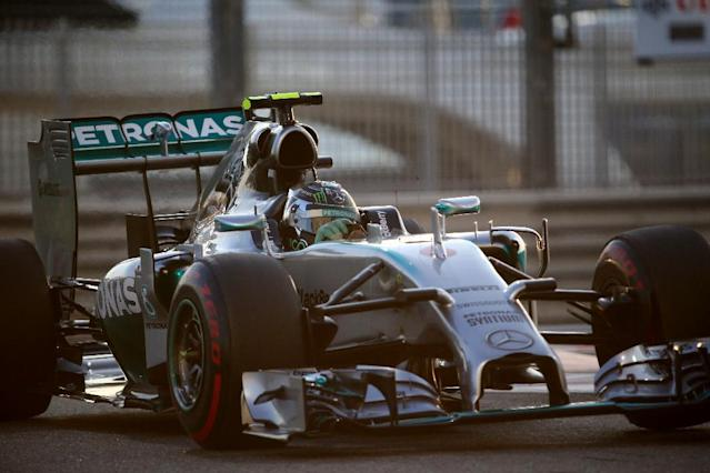 Mercedes-AMG's German driver Nico Rosberg powers through a turn during the qualifying session at the Yas Marina circuit in Abu Dhabi on November 22, 2014, ahead of the Abu Dhabi Formula One Grand Prix. AFP PHOTO/ MARWAN NAAMANI (AFP Photo/MARWAN NAAMANI)