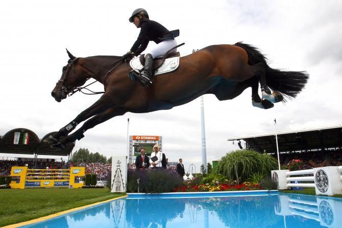 Photo from the Rolex Grand Prix in 2013. Meredith Michaels-Beerbaum Bella Donna jumps during the Chio competition. [Image Credit: Christof Koepsel/Bongarts/Getty Images]