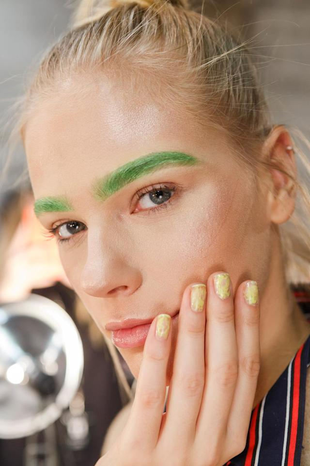 <p>Manicurist Tee Hundley is the mastermind behind these pastel green nails. (Photo: Imaxtree) </p>