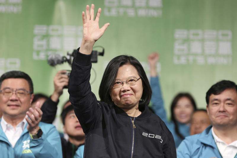FILE - In this Jan. 11, 2020, file photo, Taiwanese President Tsai Ing-wen celebrates her victory with supporters in Taipei, Taiwan. Tsai was inaugurated for a second term on Wednesday, Nay 20, 2020, amid increasing pressure from China on the self-governing island democracy it claims as its own territory.(AP Photo/Chiang Ying-ying, File)