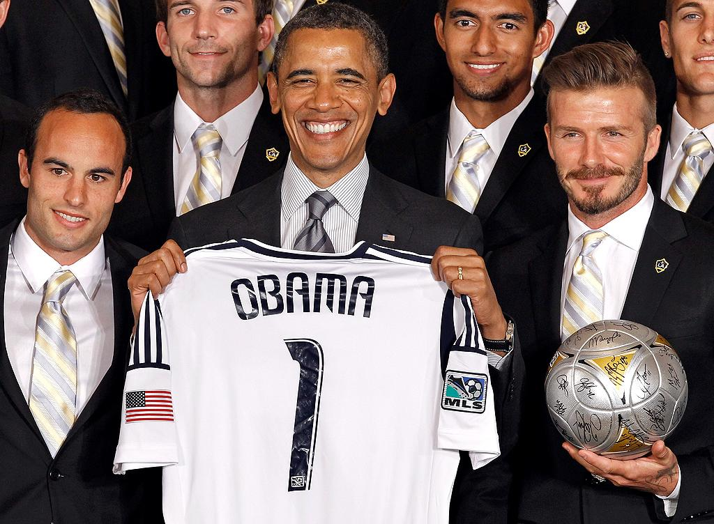 "Well, if things don't work out this November, President Obama might have a new gig to fall back on. He showed off his very own L.A. Galaxy jersey when the team<span style=""font-size:11.0pt; ""> –</span> including star players Landon Donovan (L) and David Beckham (R) <span style=""font-size:11.0pt; "">– </span>visited the White House on Tuesday. Some of the guys also joined first lady Michelle Obama for a ""Let's Move!"" question and answer session with school-age kids. (5/15/2012)"