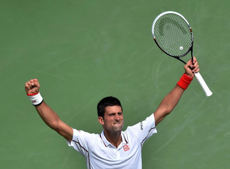Novak Djokovic celebrates a point against Germany's Philipp Kohlschreiber during their 2014 US Open fourth round match in New York, on September 1, 2014 (AFP Photo/Stan Honda)