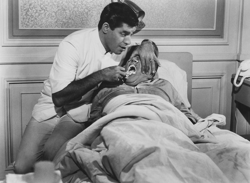 <p>Lewis scored another big hit playing an orderly at a sanitarium who exhibits the same symptoms as the patients he comes in contact with. (Photo: Everett Collection) </p>