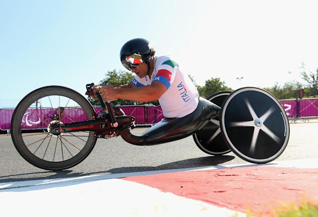 LONDON, ENGLAND - SEPTEMBER 05: Alex Zanardi of Italy in action on his way to winning the gold medal in the Men's Individual H4 Time Trial on day 7 of the London 2012 Paralympic Games at Brands Hatch on September 5, 2012 in London, England. (Photo by Bryn Lennon/Getty Images)