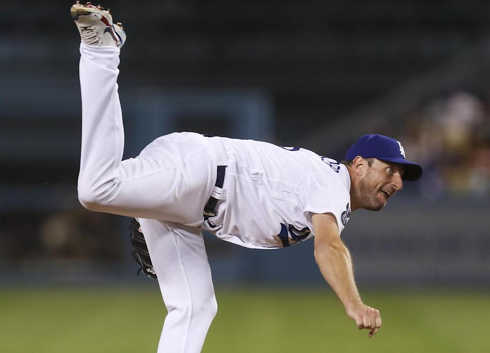 Dodgers pitcher Max Scherzer follows through as he delivers a pitch against the San Diego Padres.