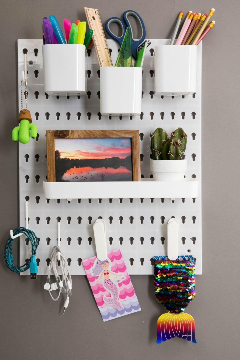"""<p>This £2 peg board — which quickly became a sensation on Instagram after it launched — is hailed for its practicality and style. We love that it can be used in any room, whether it be the study, garden shed or <a href=""""https://www.housebeautiful.com/uk/lifestyle/shopping/g27252656/kitchen-accessories/"""" rel=""""nofollow noopener"""" target=""""_blank"""" data-ylk=""""slk:kitchen"""" class=""""link rapid-noclick-resp"""">kitchen</a>. </p>"""