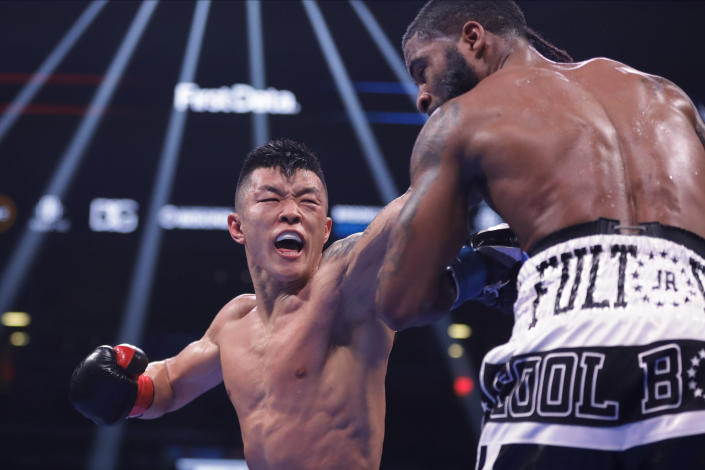 Ukraine's Arnold Khegai, left, punches Stephen Fulton during the 11th round of a WBO Intercontinental Jr. featherweight championship boxing match Saturday, Jan. 25, 2020, in New York. Fulton won the fight. (AP Photo/Frank Franklin II)