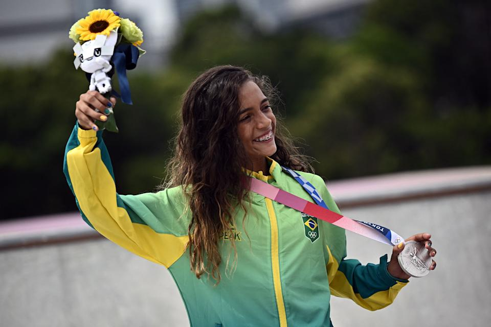 Brazil's Rayssa Leal poses with her silver medal during the podium ceremony of the skateboarding women's street final of the Tokyo 2020 Olympic Games at Ariake Sports Park in Tokyo on July 26, 2021. (Photo by Jeff PACHOUD / AFP) (Photo by JEFF PACHOUD/AFP via Getty Images)